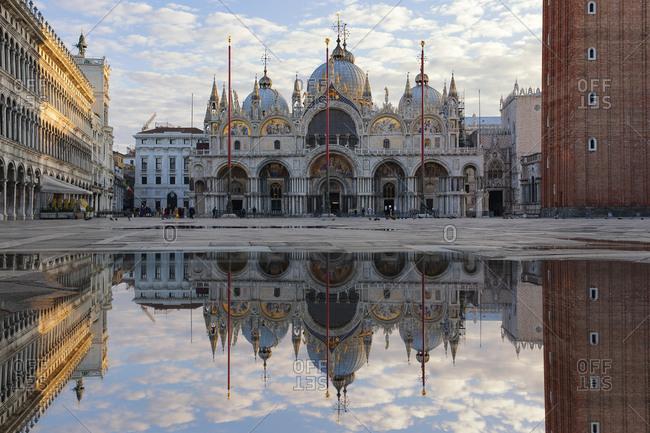 Italy- Veneto- Venice- St Mark's Square with St. Mark's Basilica- mirrored