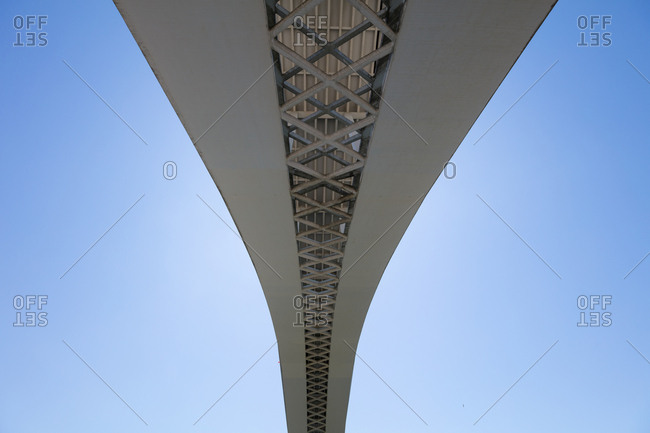 View from below of an arch of a bridge