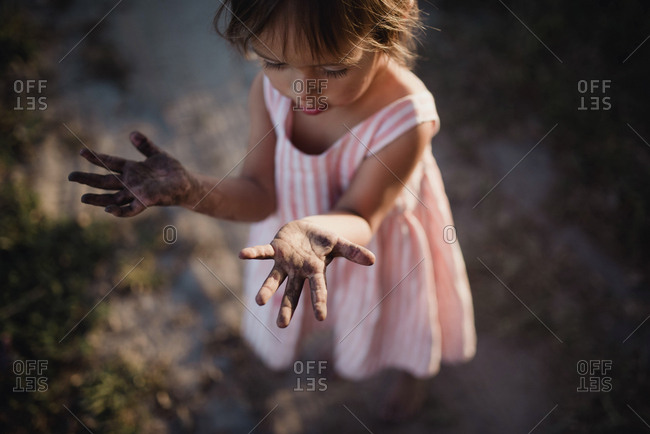 Toddler showing her dirty hands