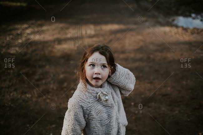Portrait of little girl outside in yard