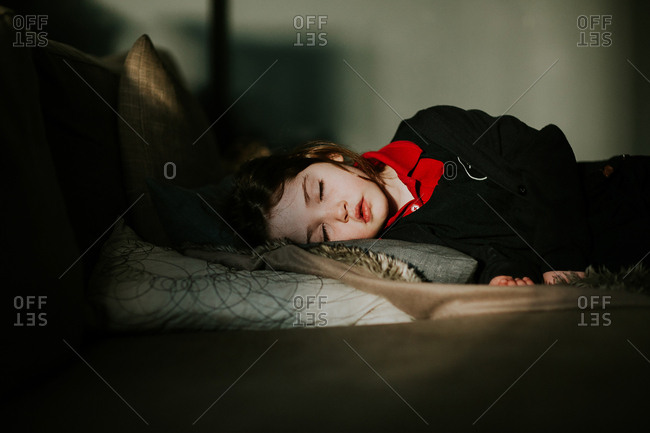 Little girl napping after a hard day at school