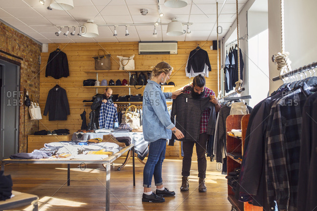 Friends choosing clothes in store