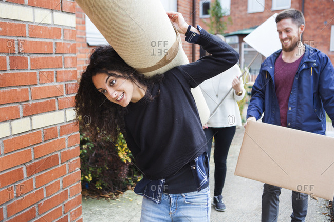 Women and man moving house