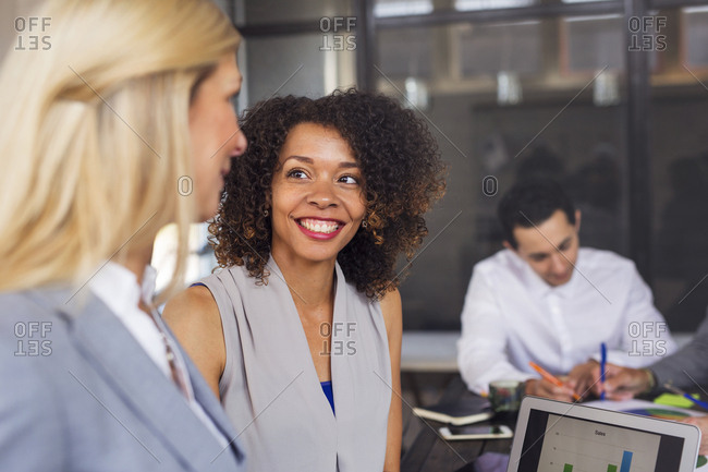 Business people laughing in office