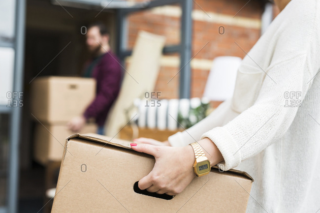 Man and woman moving house