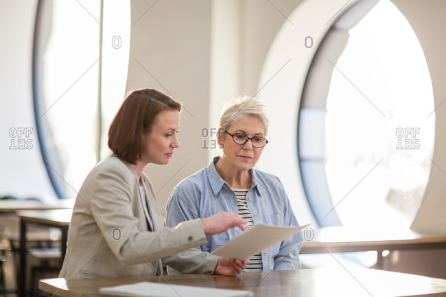 Senior woman with personal finance advisor