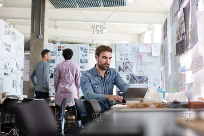 Designers working in an open plan office space
