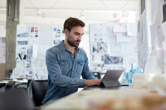 Young adult male working in creative office