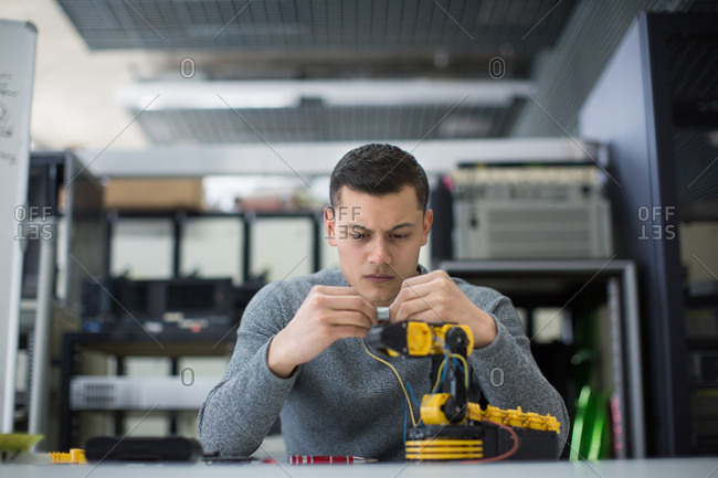 Young adult working on robotic technology