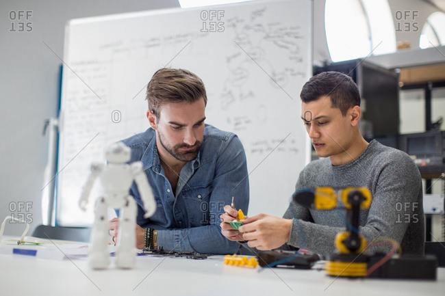 Colleagues working on robotic technology
