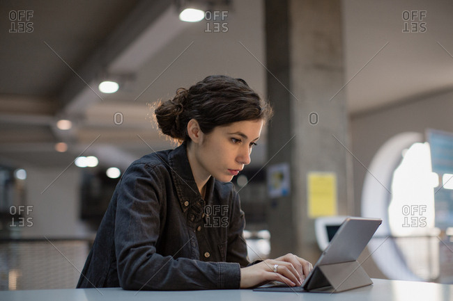 Young adult female working on digital tablet