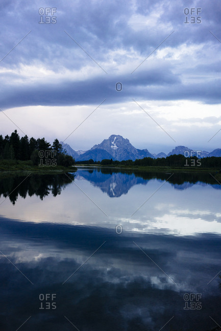 Scenic view of lake and mountain against cloudy sky at Grand Teton National Park