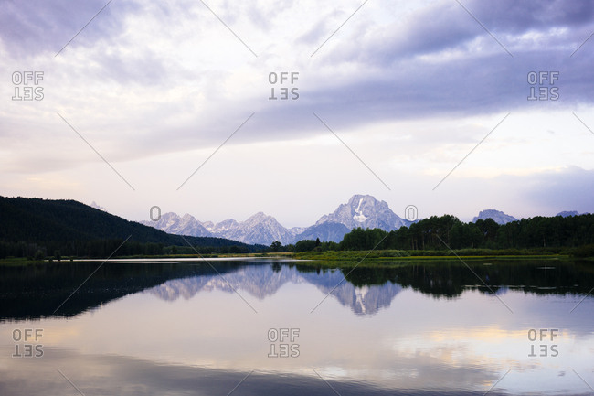 Idyllic view of lake and mountain against sky at Grand Teton National Park during sunset