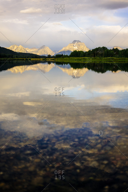 Scenic view of lake and mountain range against sky at Grand Teton National Park