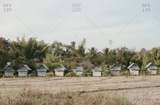 Row of small houses in a field