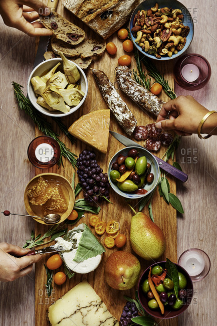 Appetizer board with hands