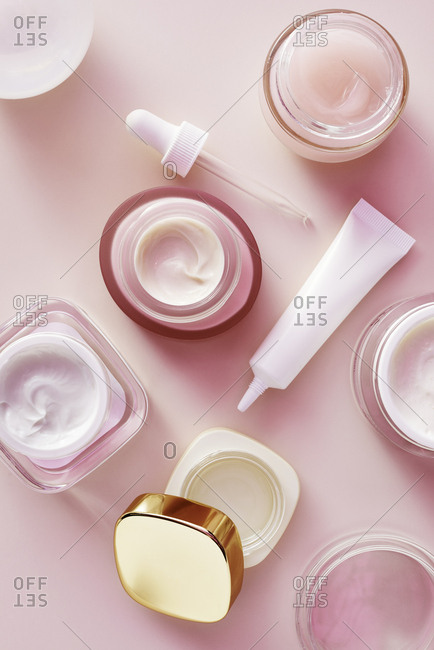 Beauty products on pink background