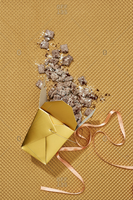 Hazelnut puppy chow on gold background