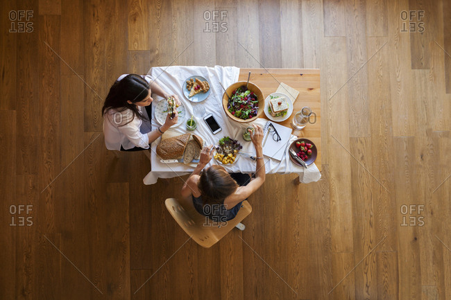 Overhead view of two women eating lunch together
