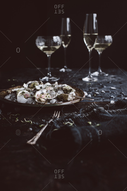 Oysters served on ice with wine