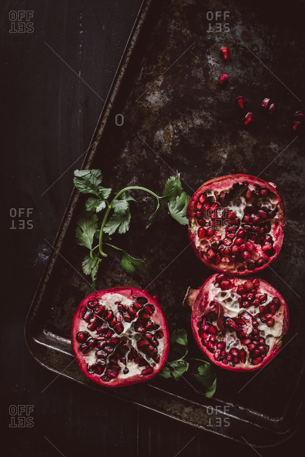 Pomegranates on old baking tray
