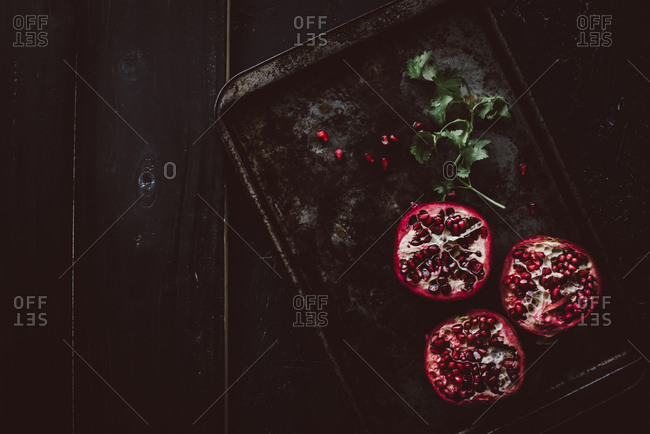 Overhead view of pomegranates on old baking tray