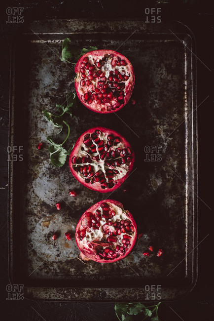 Top view of pomegranates on old baking tray
