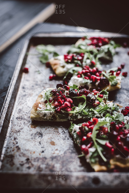 Close up of ricotta flatbread with pomegranate salsa