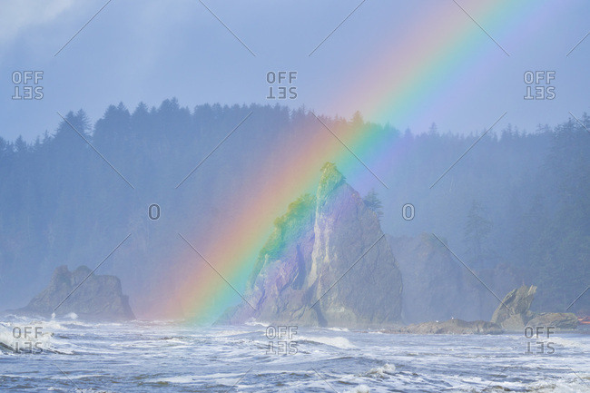 Rainbow over rock formations at Olympic National Park, Washington