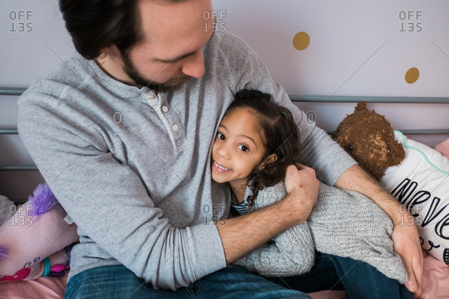 Father and daughter hanging out in her bedroom