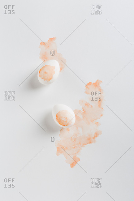 Pair of painted eggs on light background