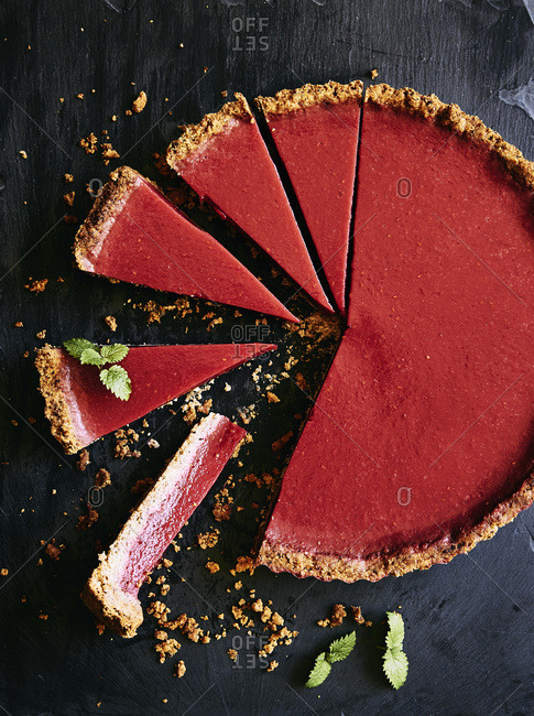 Gluten, dairy free and refined sugar rhubarb and raspberry tart With a hazelnut, toasted coconut and gluten free flour base