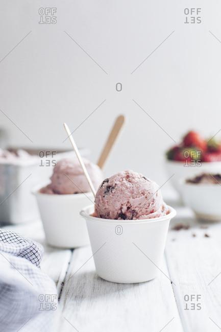 Strawberry ice cream in white cups