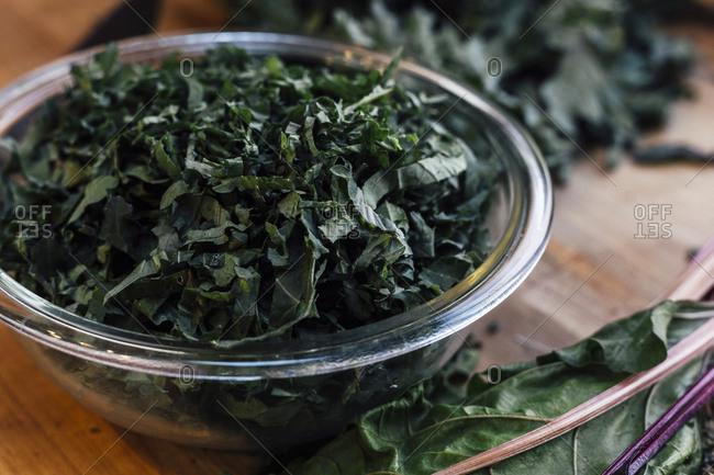 Glass bowl of chopped kale, Swiss chard