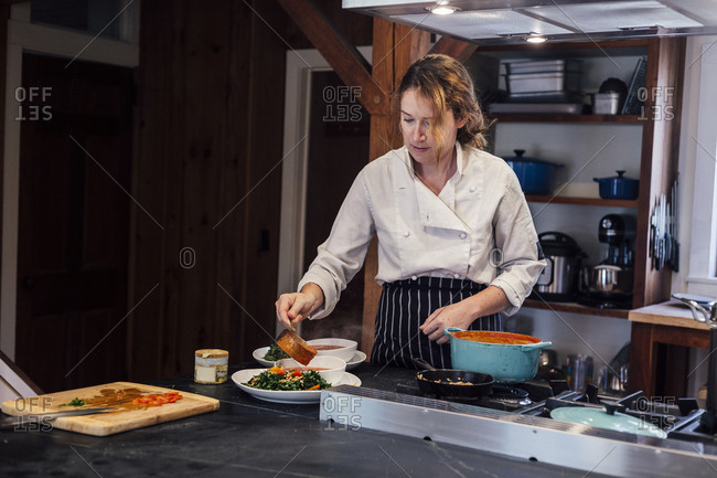 Chef plating food in kitchen