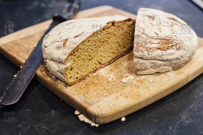 freshly baked bread cut on cutting board