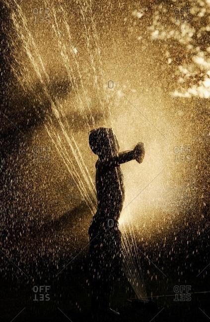 St. Albert, Alberta, Canada - June 24, 2005: Playing In The Sprinkler