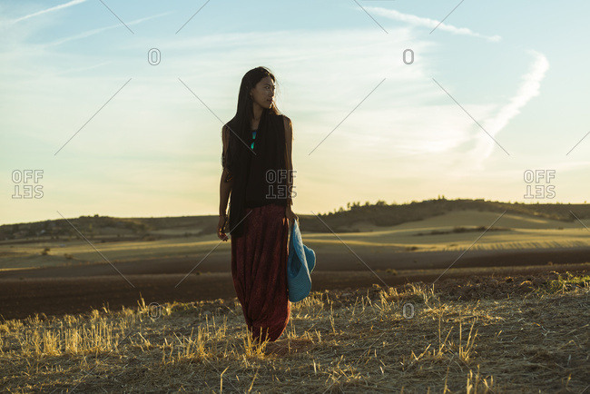 Madrid, Spain - September 15, 2015: A Young Asian Woman Walking In A Golden Wheat Field; Madrid, Spain