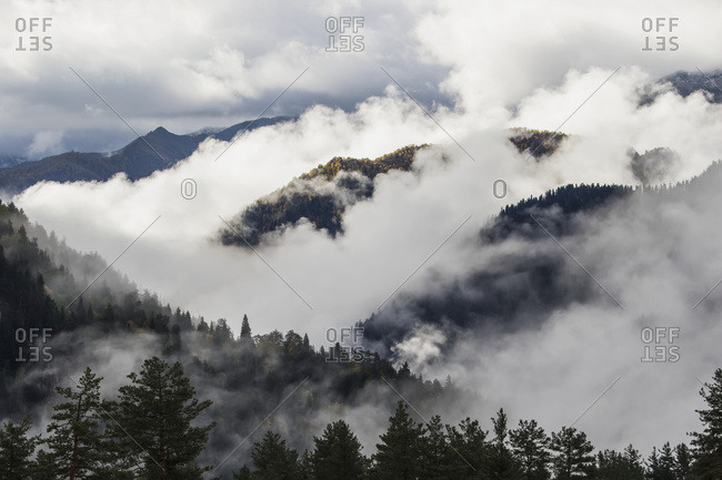 Samegrelo-Zemo Svaneti, Georgia - October 8, 2015: Clouds In The Forested Valleys Between Mestia And Ushguli, Upper Svaneti; Samegrelo-Zemo Svaneti, Georgia