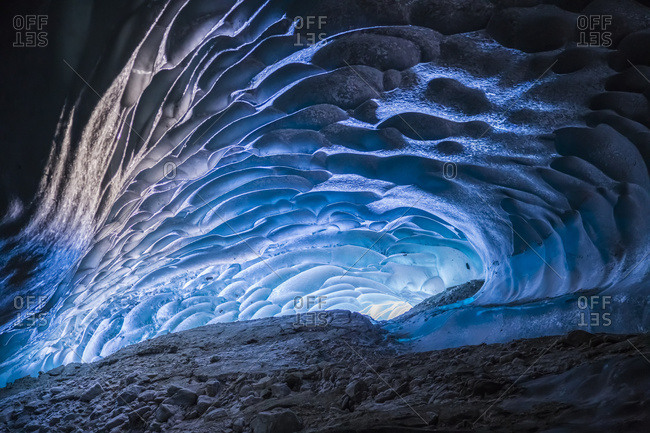 Alaska, United States of America - March 1, 2015: Light Shines Into A Cave Within Canwell Glacier In The Alaska Range, Hdr Composite; Alaska, United States Of America