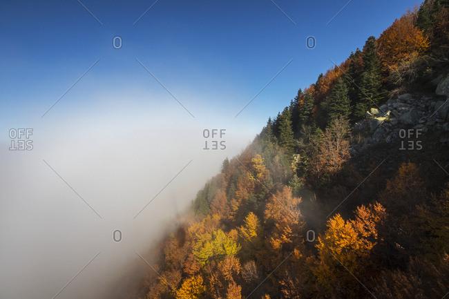 Bursa, Turkey - November 7, 2015: View From The Bursa Uludag Gondola Of Fog Along The Hillside With A Forest In Autumn Colors; Bursa, Turkey