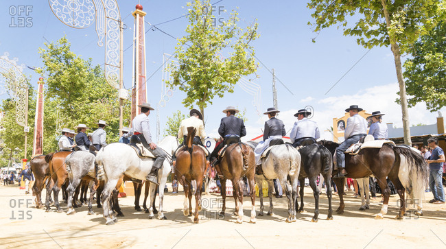 Jerez, Spain - May 1, 2016: Spanish horsemen and women standing in a line at the Jerez Horse festival