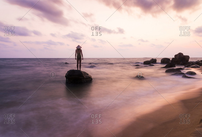 Female tourist at sunset on the island of Phu Quoc, Vietnam