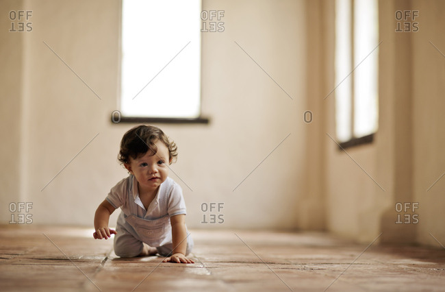 Toddler crawling in the hallway.