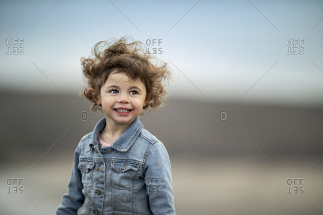 Cheerful young girl at the beach.