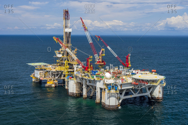 West Africa - September 25, 2009: High angle view of oil exploration platform amidst sea