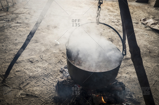 High angle view of stew cooking in utensil at barn