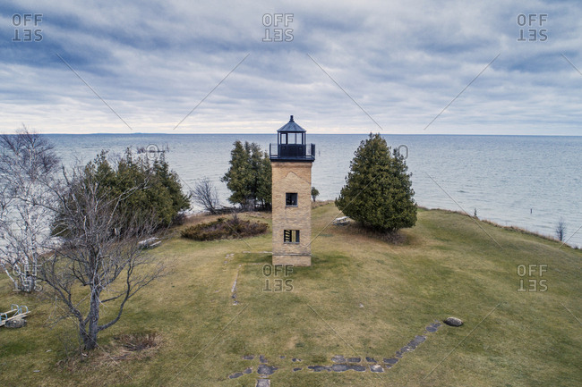 High angle view of lighthouse by Grand River against cloudy sky