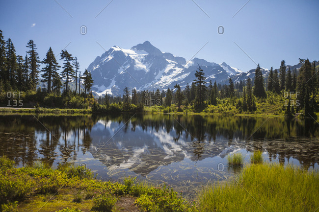 Scenic view of lake against mountains during winter at North Cascades National Park