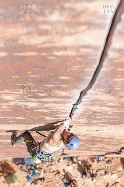 High angle view of female hiker rock climbing